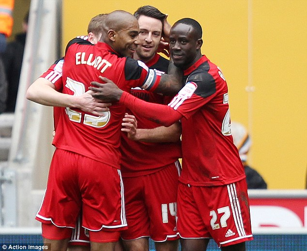 Opening goal: Bristol City's Marvin Elliott, Liam Kelly and Albert Adomah celebrate the own goal from Davis that put them in front on 25 minutes