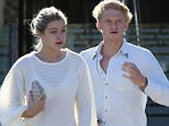 EXCLUSIVE COLEMAN-RAYNER, Malibu, CA, December 26th, 2014.  Young couple Gigi Hadid and Cody Simpson have Boxing Day breakfast at Coogies Beach Cafe in Malibu. The make-up free American model was dressed casually in a white knitted sweater, flip-flops and sweat pants. Cody wore blue jeans, boots and also a white top during the breakfast outing. CREDIT LINE MUST READ: Coleman-Rayner. Tel US (001) 310-474-4343- office www.coleman-rayner.com
