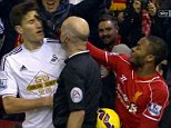 Liverpool v Swansea Sterling lucky to get away with this swipe around the face on Fernandez sky grabs