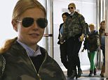 Please contact X17 before any use of these exclusive photos - x17@x17agency.com   PREMIUM EXCLUSIVE - Gwyneth Paltrow and her children, Apple and Moses, were spotted at JFK in NYC.  The star was dressed in a camouflaged jacket and black pants, on Sunday, December 28, 2014 X17online.com