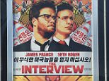 "MESQUITE, NV - DECEMBER 25:  A movie poster for ""The Interview"" is displayed outside the Megaplex Theatres - Stadium 6 as the Sony Pictures' film opens on Christmas Day on December 25, 2014 in Mesquite, Nevada. Sony hackers have been releasing stolen information and threatened attacks on theaters that screen the film.  (Photo by Ethan Miller/Getty Images)"