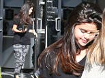 UK CLIENTS MUST CREDIT: AKM-GSI ONLY\nEXCLUSIVE: Calabasas, CA - Makeup-free Selena Gomez spends some time pampering herself in Calabasas as she is spotted leaving  Luxury Tan and Makeovers.  The baby faced brunette wore a black tshirt and black and white printed pants as she made her way out the door.\n\nPictured: Selena Gomez\nRef: SPL918222  271214   EXCLUSIVE\nPicture by: AKM-GSI / Splash News\n\n
