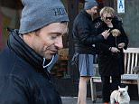 Hugh Jackman and Deborra-Lee Furness seen at a West Village cafe with their new puppy.\n\nPictured: Hugh Jackman, Deborra-Lee Furness, Dali, poodle-mix puppy\nRef: SPL917827  271214  \nPicture by: Doug Meszler / Splash News\n\nSplash News and Pictures\nLos Angeles: 310-821-2666\nNew York: 212-619-2666\nLondon: 870-934-2666\nphotodesk@splashnews.com\n
