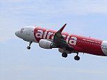 In this May 9, 2014 photo, an Air Asia A320-200 plane takes off from Kuala Lumpur International Airport 2 in Sepang, Malaysia. An AirAsia plane with 161 people on board lost contact with ground control on Sunday, Dec. 28, 2014,  while flying over the Java Sea after taking off from a provincial city in Indonesia for Singapore, and search and rescue operations were underway.  AirAsia, a regional low-cost carrier with presence in several Southeast Asian countries, said in a statement that the missing plane was an Airbus A320-200 and that search and rescue operations were in progress. The plane in this photo is the same model but not the one which went missing in Indonesia Sunday.  (AP Photo/Joshua Paul)
