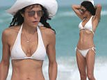 130765, EXCLUSIVE: Bethenny Frankel and her boyfriend Michael Cerussi take her daughter Bryn for a day at the beach in Miami. The 'Real Housewives of NYC' star, who is returning to the hit show, showed off her slender but toned figure in a white bikini and a white sun hat. Michael appeared affectionate towards Bryn helping her collect sea shells and making her laugh. Bethenny and Michael are in Miami with her 4 year old Bryn to celebrate the new year. Miami, Florida - Monday December 29, 2014. Photograph: Brett Kaffee © Pacific Coast News. Los Angeles Office: +1 310.822.0419 London Office: +44 208.090.4079 sales@pacificcoastnews.com FEE MUST BE AGREED PRIOR TO USAGE