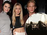Kendall Jenner, left, Gigi Hadid and Cody Simpson attend Just Jared's Homecoming Dance presented by Ever After High at the El Rey Theatre on Thursday, November 20, 2014, in Los Angeles. (Photo by Todd Williamson/Invision for Just Jared/AP Images)