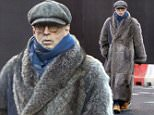 Rock guitarist Eric Clapton wrapped up for winter in a floor length fur coat is photographed out in London on Monday (29/12/2014)\nPicture by John Almassi  (NO CREDIT)