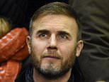 British musician Gary Barlow is seen in the crowd ahead of the English Premier League football match between Liverpool and Swansea City at Anfield in Liverpool, north west England, on December 29, 2014.  AFP PHOTO / PAUL ELLIS RESTRICTED TO EDITORIAL USE. No use with unauthorized audio, video, data, fixture lists, club/league logos or live services. Online in-match use limited to 45 images, no video emulation. No use in betting, games or single club/league/player publications.PAUL ELLIS/AFP/Getty Images