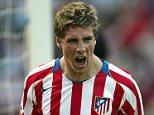 MADRID, SPAIN:  Atletico de Madrid's, Fernando Torres celebrates after a goal during their Spanish football league match at the Vicente Calderon stadium in Madrid 17 October 2004. AFP PHOTO/ Pedro ARMESTRE.  (Photo credit should read PEDRO ARMESTRE/AFP/Getty Images)