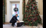 President Obama Opens A Christmas Gift