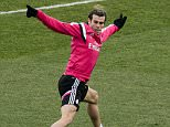 Real Madrid's Welsh forward Gareth Bale takes part in a training session at the Valdebebas training center in Madrid on December 28, 2014.  AFP PHOTO / DANI POZODANI POZO/AFP/Getty Images