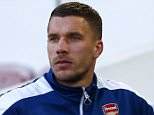 LONDON, ENGLAND - DECEMBER 28:  Lukas Podolski of Arsenal takes his seat on the bench before the Barclays Premier League match between West Ham United and Arsenal at Boleyn Ground on December 28, 2014 in London, England.  (Photo by Julian Finney/Getty Images)