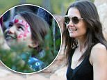 EXCLUSIVE: Katie Holmes and her daughter Suri Cruise had a great new years eve by spending the day with famed fashion designer Zac Posen at the happiest place on earth. Suri, who had her face painted, stayed close to her mom and joked with Zac, who she seemed pretty close with, rode many rides. The entire group were seen riding the big thunder mountain roller coaster and pirates of the caribean. \n\nPictured: Katie Holmes, Suri Cruise and Zac Posen\nRef: SPL918544  311214   EXCLUSIVE\nPicture by: Fern / Splash News\n\nSplash News and Pictures\nLos Angeles: 310-821-2666\nNew York: 212-619-2666\nLondon: 870-934-2666\nphotodesk@splashnews.com\n