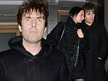 EXCLUSIVE ALL ROUND PICTURE: PALACE LEE / MATRIXPICTURES.CO.UK PLEASE CREDIT ALL USES WORLD RIGHTS English musician Liam Gallagher and his girlfriend, former personal assistant Debbie Gwyther are pictured leaving Nobu restaurant in London's West End after enjoying a New Year dinner together on New Year's Eve. DECEMBER 31st 2014 REF: LTN 145255