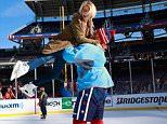 WASHINGTON, DC - DECEMBER 31:  Brooks Laich #21 of the Washington Capitals and actress Julianne Hough skate during the 2015 Bridgestone NHL Winter Classic practice day on December 31, 2014 at Nationals Park in Washington, DC.  The 2015 Bridgestone NHL Winter Classic will take place on New Year's Day with the Washington Capitals playing the Chicago Blackhawks.  (Photo by Jeff Vinnick/NHLI via Getty Images)