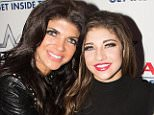 FREEHOLD, NJ - DECEMBER 26:  Teresa Giudice, Gia Giudice and Joe Giudice pose  at iPlay America on December 26, 2014 in Freehold, New Jersey.  (Photo by Dave Kotinsky/Getty Images)