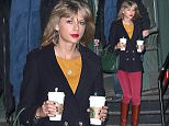 Taylor Swift walks out of her apartment double-fisting two grande Starbucks coffees, wearing red pants and carrying a green purse on New Year's Day in NYC\n\nPictured: Taylor Swift\nRef: SPL919520  010115  \nPicture by: XactpiX\n\nSplash News and Pictures\nLos Angeles: 310-821-2666\nNew York: 212-619-2666\nLondon: 870-934-2666\nphotodesk@splashnews.com\n
