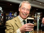 Ukip leader Nigel Farage joins Ukip MLA David McNarry for a pint at the Europa Hotel in Belfast, Northern Ireland.  Nigel Farage was accused of ?stealing language from the BNP? as he was hit by the growing storm over his remarks about Romanians in Britain. Ukip took out an advert in a national newspaper to try to defuse a row after Mr Farage suggested that Londoners would be concerned if a group of Romanian men moved in next door. Faced with accusations of ?racism?, Mr Farage last night expressed ?regret? for his controversial remarks. But today he took out an advert in The Daily Telegraph to defend his arguments that Romanian immigrants are to blame for an increase in crime, particularly at cashpoint machines. The ad includes the sub-headline ?All We Want is Our Country Back?.  PRESS ASSOCIATION Photo. Picture date: Wednesday May 14, 2014. See PA story POLITICS Immigration Ukip. Photo credit should read: Paul Faith/PA Wire
