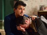 WARNING: Embargoed for publication until: 26/12/2014 - Programme Name: EastEnders - TX: 07/01/2015 - Episode: 4993 (No. n/a) - Picture Shows: ***HOLD BACK FOR COMMS.. Charlie sobs as he tells Nick that Ronnie didn't wake up.  Nick Cotton (John Altman), Charlie Cotton (DECLAN BENNETT) - (C) BBC - Photographer: Kieron McCarron