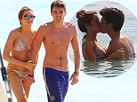 EXCLUSIVE: Union J member Josh Cuthbert couldn't stop from kissing his rumored new girlfriend Chloe Lloyd as they took in dip in the ocean. The couple later emerged and walked hand in hand back to their loungers.  Pictured: Josh Cuthbert, Chloe Lloyd Ref: SPL921574  060115   EXCLUSIVE Picture by: PRIMADONNA/GEMAIRA/Splash News  Splash News and Pictures Los Angeles: 310-821-2666 New York: 212-619-2666 London: 870-934-2666 photodesk@splashnews.com
