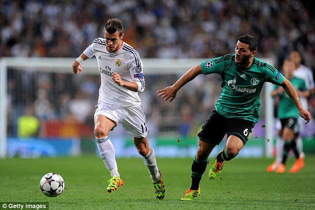Settled: Bale (left) has increasingly looked at ease in Spanish football over the past few months
