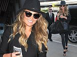 12 January 2015. Chrissy Teigen seen at Los Angeles International Airport, USA. Credit: BG/GoffPhotos.com   Ref: KGC-300/150112NR2 **UK, Spain, Italy, China Sales Only**