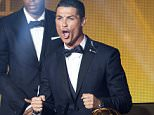 Cristiano Ronaldo, right, of Portugal celebrates after winning the FIFA Men's soccer player of the year 2014 prize at the FIFA Ballon d'Or awarding ceremony at the Kongresshaus in Zurich, Switzerland, Monday,  Jan. 12, 2015. (AP Photo/KEYSTONE,Ennio Leanza)