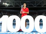 BRISBANE, AUSTRALIA - JANUARY 11:  Roger Federer of Switzerland holds the Roy Emerson trophy after winning his 1000 singles title after the Mens final match against Milos Raonic of Canada during day eight of the 2015 Brisbane International at Pat Rafter Arena on January 11, 2015 in Brisbane, Australia.  (Photo by Chris Hyde/Getty Images)