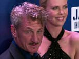 Extra :Sean Penn?s 4th annual Help Haiti Home Gala  All the big stars turned out for Sean Penn?s 4th annual Help Haiti Home Gala in L.A. this weekend, including Penn?s girlfriend, Charlize Theron.  The couple walked the red carpet together, and speaking with ?Extra?s? Jerry Penacoli, who had to ask the big question: Did Sean ask Charlize to marry him over the holidays? Jerry, ?Are you going to make it official or get married at some point.?  Sean saying, ?I can?t even say things out loud.?  Jerry asking, ?Last time you told me mums the word about even being in a relationship, so you are saying mums the word about an engagement?? Sean played coy, ?I just hate looking at people on television talking about their relationships.?   Penacoli commented on how happy Penn looked. The actor smiled, ?I can?t imagine why& she and I have been very, very longtime friends. We hit a speed bump and must have lost our minds, so here we are.?