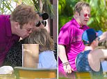 UK CLIENTS MUST CREDIT: AKM-GSI ONLY\nEXCLUSIVE: **SHOT ON 1/9/15** Sir Elton John is seen at lunch while on vacation in Hawaii. The 'Candle in the Wind' singer sat next to friend Neil Patrick Harris and was seen doing a toast during the lunch. \n\nPictured: Elton John\nRef: SPL927528  130115   EXCLUSIVE\nPicture by: AKM-GSI / Splash News\n\n