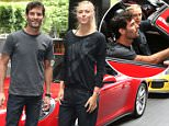 Tennis player Maria Sharapova and racing car driver Mark Webber prepare to drive in a Porsche to the Australian tennis centre in Melbourne for a car promotion, Wednesday, Jan 14. 2015. The Australian Open begins on Monday. (AAP Image/David Crosling) NO ARCHIVING