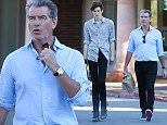 UK CLIENTS MUST CREDIT: AKM-GSI ONLY\nEXCLUSIVE: Former 'James Bond', American-Irish actor Pierce Brosnan and his model son Dylan run a few errands in Malibu, the stylish duo picked up some reading material at a local news stand before doing a bit of shopping at Rite Aid Pharmacy. Although already standing tall at 6ft 1in, Pierce was quite a bit shorter than his teenage son, whose mother is the actor's second wife, Keely Shaye Smith.\n\nPictured: Pierce Brosnan and Dylan Brosnan\nRef: SPL927288  130115   EXCLUSIVE\nPicture by: AKM-GSI / Splash News\n\n