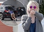 UK CLIENTS MUST CREDIT: AKM-GSI ONLY EXCLUSIVE: Dakota Fanning was driving in Studio City when she ran out of gas.  The actress enlisted the help of some good samaritans who helped push her car off to the side while she made a quick phone call to her father.  Steven Fanning quickly came through and filled up a gas can at the nearby Shell Station and rushed to the aid of his daughter.  Pictured: Dakota Fanning Ref: SPL927437  130115   EXCLUSIVE Picture by: AKM-GSI / Splash News