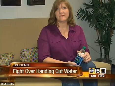 Helping out: Dana Crow-Smith said she was offering free bottled water at a festival in Phoenix, Arizona as both a kind gesture and way to offer conversation on Christianity