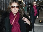 January 16, 2015: Elizabeth Hurley greets makes her way through LAX airport in Los Angeles, CA.  \nMandatory Credit: INFphoto.com Ref.: inf-00