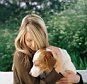 Woman holding pet dog.