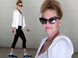 Melanie Griffith arrives at the gym in Beverly Hills with messy hair. January 16, 2015 X17online.com