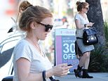 Picture Shows: Isla Fisher  January 16, 2015\n \n Actress and busy mom Isla Fisher takes her daughters Elula & Olive to Pinkberry in West Hollywood, California. Isla, who hid her growing baby bump behind her purse, is expecting her third child with husband Sacha Baron Cohen.\n \n Exclusive All Rounder\n UK RIGHTS ONLY\n Pictures by : FameFlynet UK © 2015\n Tel : +44 (0)20 3551 5049\n Email : info@fameflynet.uk.com