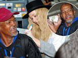 Singer Iggy Azalea gives a homeless man an autographed $20 bill as she fills up her car with gas in Westwood, CA. The popular Australian Rapper also posed for a selfie with the man who proudly showed off the $20 bill afterwards.\n\nPictured: Iggy Azalea\nRef: SPL929690  160115  \nPicture by: London Entertainment/Splash News\n\nSplash News and Pictures\nLos Angeles: 310-821-2666\nNew York: 212-619-2666\nLondon: 870-934-2666\nphotodesk@splashnews.com\n
