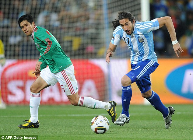 Ex-Argentina midfielder Gutierrez drives forward during his country's World Cup clash with Mexico in 2010