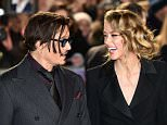 US actor Johnny Depp (L) jokes with fiancee US actress and model Amber Heard (R) as they arrive for the UK premiere of the film 'Mortdecai' in London on January 19, 2015.  AFP PHOTO / LEON NEALLEON NEAL/AFP/Getty Images