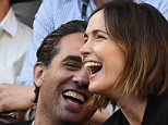 epa04568373 Australian actor Rose Byrne (R) and Bobby Cannavale  watch Switzerland's Roger Federer play Taipei's Yen-Hsun Lu in their first round match at the Australian Open Grand Slam tennis tournament in Melbourne, Australia, 19 January 2015.  EPA/JOE CASTRO AUSTRALIA AND NEW ZEALAND OUT