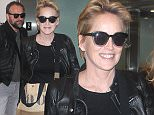 Sharon Stone arriving at LAX with friends and signs autographs January 18, 2015 X17online.com