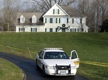 FILE - In this Dec. 18, 2012 file photo a police cruiser sits in the driveway of the home of Nancy Lanza, in Newtown, Conn. The Newtown Legislative Council is voting Wednesday, Jan. 21, 2015 on a proposal recommended by the board of selectmen to raze the 3,100-square-foot home and keep the land as open space. The Colonial-style home where Newtown school shooter Adam Lanza lived with his mother has been transferred to the town in a deal with a bank. Nancy Lanza was killed there by her son before he forced his way into Sandy Hook Elementary School, Dec. 14, 2012, in Newtown, where he killed 20 first-graders and six educators. (AP Photo/Jason DeCrow, File)
