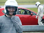 Picture Shows: Ed Sheeran  January 21, 2015    Singer Ed Sheeran is seen taking part in a lap on 'Top Gear' - despite not actually having a driving licence.    The 'Thinking Out Loud' singer appeared on the Star In A Reasonably Priced Car segment and drove an automatic Vauxhall Astra around the circuit. The twenty-three year-old has spoken about his fear of going too fast in the past when he does obtain his licence.    Non-Exclusive  WORLDWIDE RIGHTS    Pictures by : FameFlynet UK    2015  Tel : +44 (0)20 3551 5049  Email : info@fameflynet.uk.com