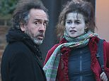 Recently split couple Helena Bonham Carter and Tim Burton pictured taking a stroll in London with their children. The couple are putting on a united front for their children especially with a very touching moment when Tim Burton receives a high five from his son.