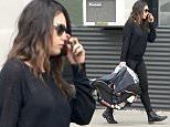 Picture Shows: Mila Kunis  January 20, 2015    ** Min Web / Online Fee   150 For Set **    Actress and new mom Mila Kunis takes her baby girl Wyatt to the hair salon in Beverly Hills, California. Rumors are swirling that Mila and her fiance Ashton Kutcher are already working on baby number two because the couple want to have their kids close in age.     ** Min Web / Online Fee   150 For Set **    Exclusive All Rounder  UK RIGHTS ONLY   Pictures by : FameFlynet UK    2015  Tel : +44 (0)20 3551 5049  Email : info@fameflynet.uk.com