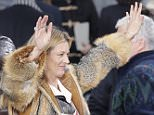 Model Kate Moss reacts at the end of the show for fashion house Louis Vuitton by designer Kim Jones during men's fall-winter 2015/2016 fashion collection, presented in Paris, France, Thursday, Jan. 22, 2015. (AP Photo/Francois Mori)