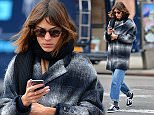 131634, EXCLUSIVE: Alexa Chung appears very absorbed in her cellphone as she is spotted in Soho. New York, New York - Wednesday January 21, 2015. Photograph:    PacificCoastNews. Los Angeles Office: +1 310.822.0419 sales@pacificcoastnews.com FEE MUST BE AGREED PRIOR TO USAGE