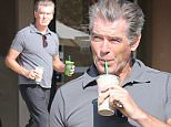 Please contact X17 before any use of these exclusive photos - x17@x17agency.com   Pierce Brosnan shows muscles while enjoying a smoothie and talking to some fans. The actor is looking really well for being 61 walking around Malibu in a tight shirt.  January 21, 2015 X17online.com